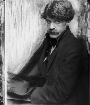 Stieglitz photographed by Gertrude Käsebier in 1902.